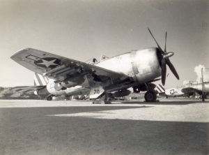A Republic P-47N Thunderbolt of the 19th Fighter Squadron, 318th Fighter Group, rests in a late war pose, probably at Ie Shima near Okinawa, with a full payload of eight M2 or M3 (higher rate of fire) .50 caliber machine guns (with up to 425 rounds per gun), ten five-inch High Velocity Aerial Rockets (HVAR) and three general purpose bombs, which appear to be a pair of 1,000-lb bombs under the wings and a single 500-lb bomb under the belly.  (Courtesy 413th Fighter Group.com)